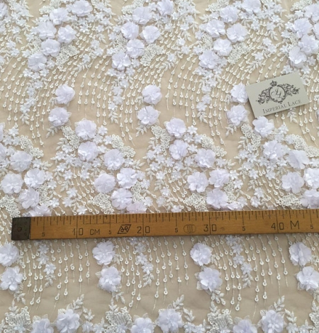 White 3D floral pattern embroidery on tulle fabric. Photo 4