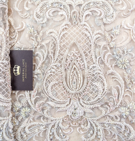 Beige embroidery on tulle fabric. Photo 1