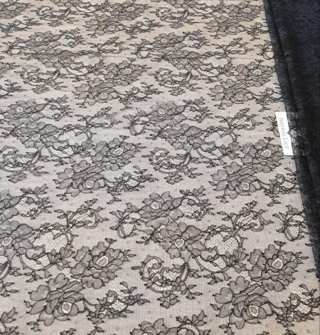 Black elastic chantilly lace fabric. Photo 6