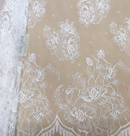 Off-white lace fabric . Photo 1