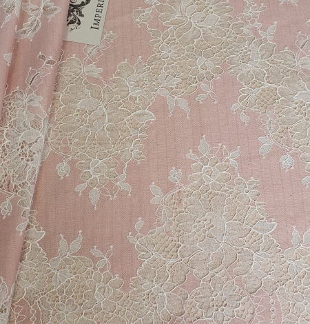 Pink with white flower pattern fabric. Photo 1