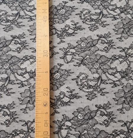 Black elastic chantilly lace fabric. Photo 7
