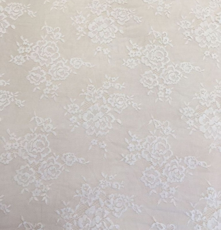 Ivory flowers with off white net chantilly lace. Photo 3