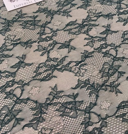 Deep teal green lace fabric. Photo 3