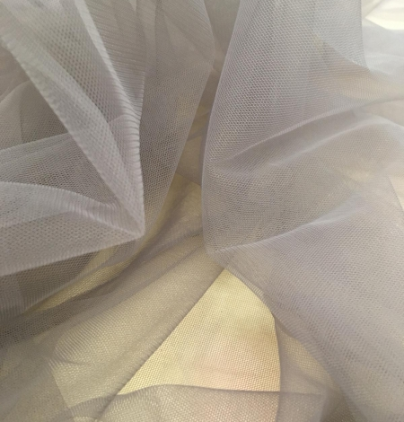 Soft grey tulle fabric with lilac shade. Photo 6