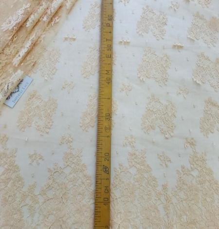 Rusty yellow lace fabric. Photo 10