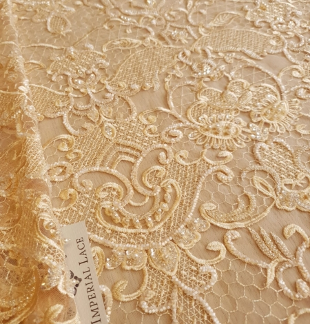 Yellow beaded lace fabric. Photo 1
