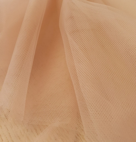 Nude 100% polyamide clear invisible tulle fabric. Photo 8