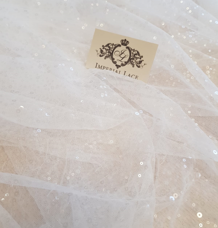 White tulle with fliters. Photo 7