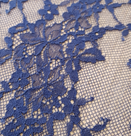 Blue 100% polyester floral chantilly lace fabric. Photo 4