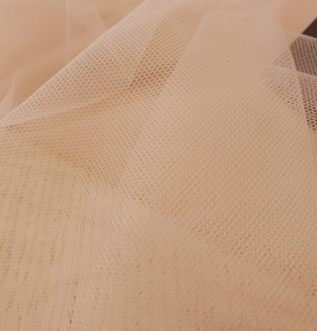 Nude 100% polyamide clear invisible tulle fabric. Photo 7