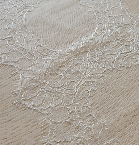Ivory chantilly lace trimming from France. Photo 5