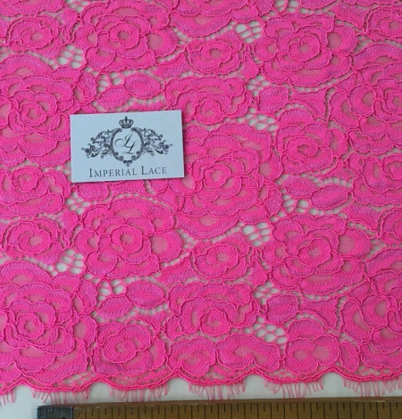 Electro pink guipure lace fabric. Photo 4