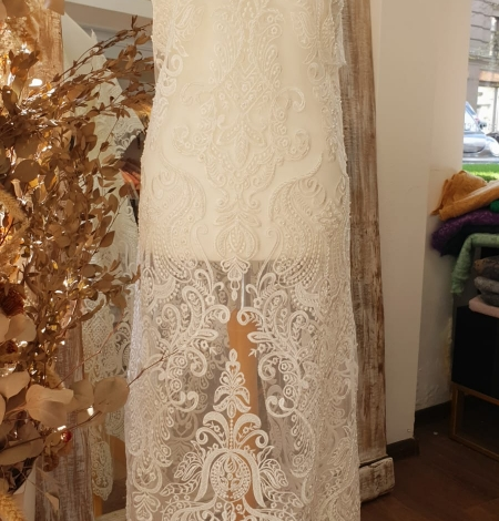 Ivory embroidery on tulle lace fabric. Photo 10