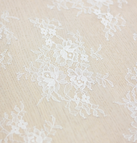 Off white floral pattern chantilly lace fabric. Photo 6