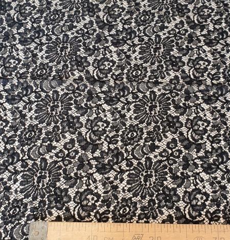 Black viscose chantilly lace fabric. Photo 6