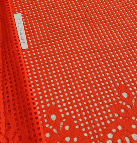 Orange red guipure lace fabric. Photo 1