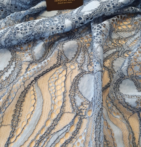 Light and dark blue chantilly lace fabric . Photo 2