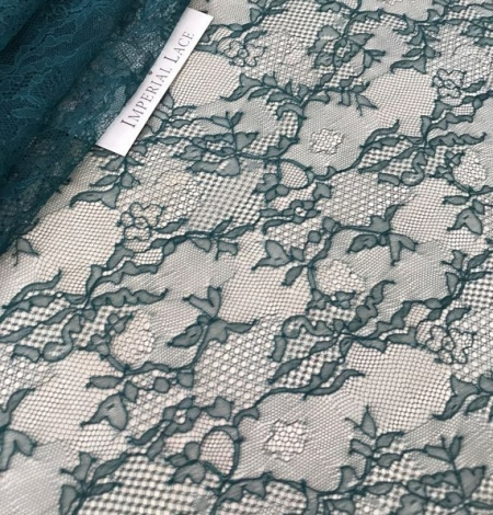 Deep teal green lace fabric. Photo 1
