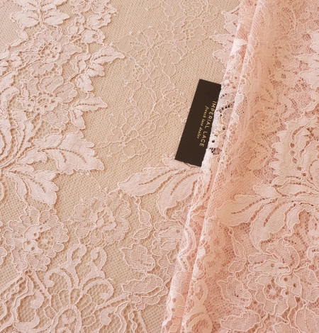 Pink guipure with chantilly lace fabric. Photo 2