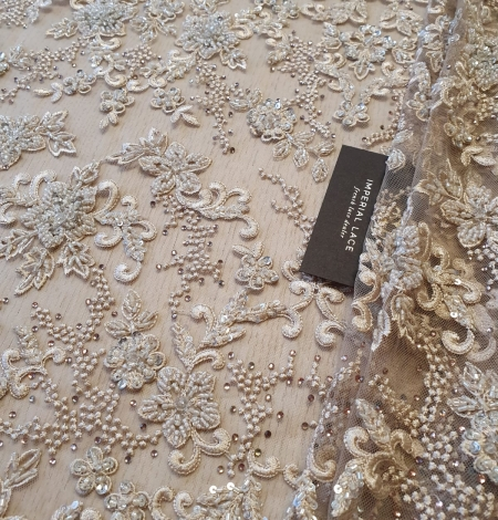 Beige beaded lace fabric. Photo 1
