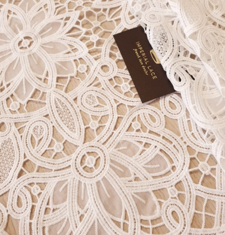 Off white macrame floral pattern with fabric details lace fabric. Photo 1