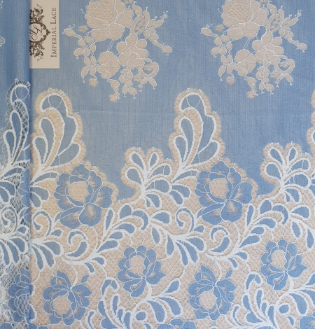 Light blue with white flower pattern fabric. Photo 1