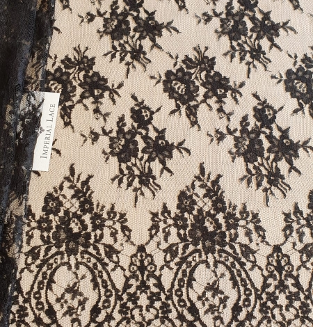 Black viscose chantilly lace fabric. Photo 1