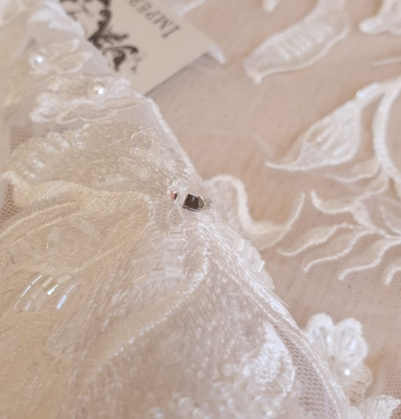 Ivory beaded floral pattern embroidery on tulle fabric. Photo 2