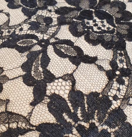Black viscose chantilly lace fabric. Photo 4