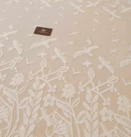 Ivory 100% polyester floral and bird pattern chantilly lace fabric. Photo 3