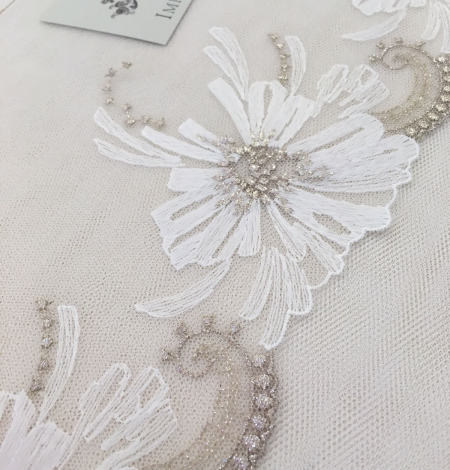 White soft embroidery on peach tulle. Photo 3