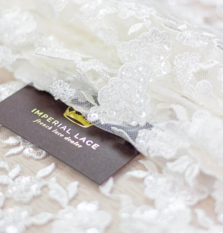 Ivory floral pattern beaded embroidery on tulle fabric. Photo 3