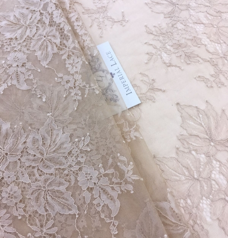 Beige lace fabric. Photo 2