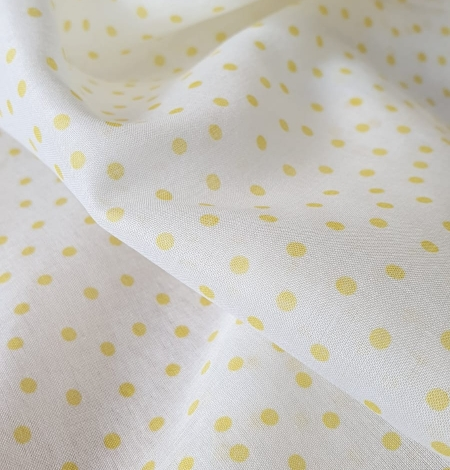 White with yellow dots cotton fabric. Photo 5