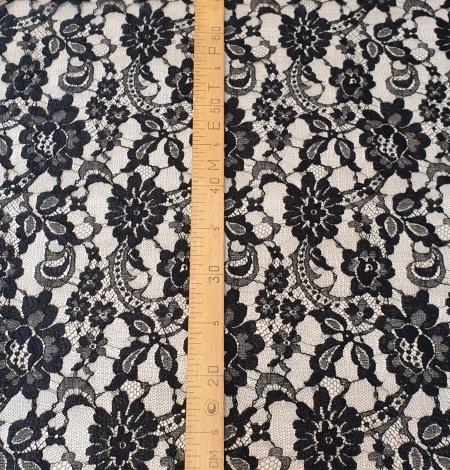 Black viscose chantilly lace fabric. Photo 7