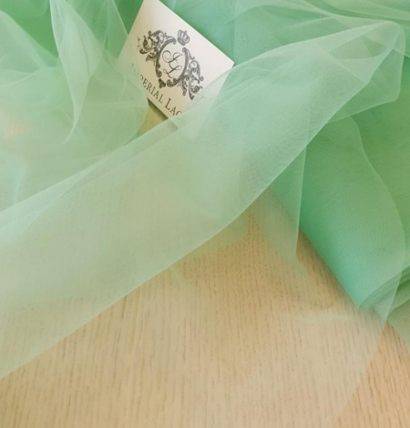 Mint green tulle fabric. Photo 1