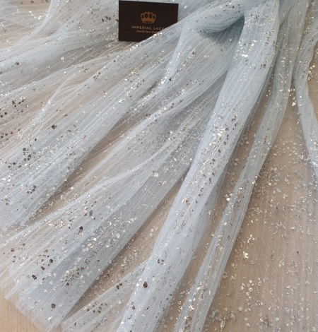 Light blue corrugated with silver spotting tulle fabric. Photo 2