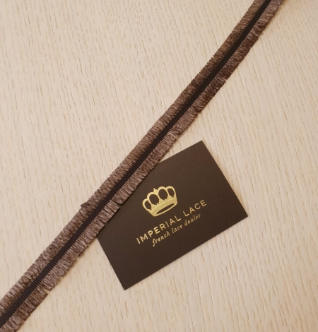 Brown plastic fringes with grosgrain ribbon application. Photo 3