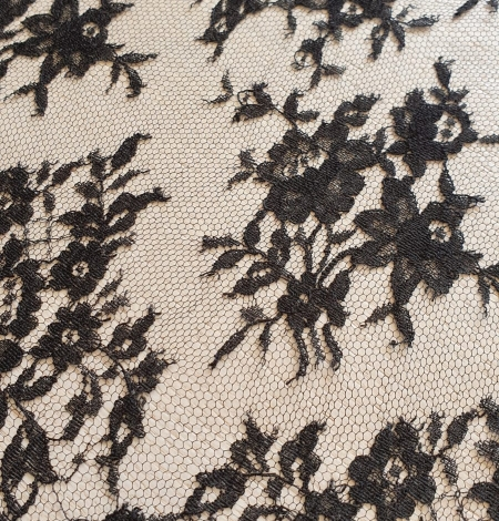 Black viscose chantilly lace fabric. Photo 5