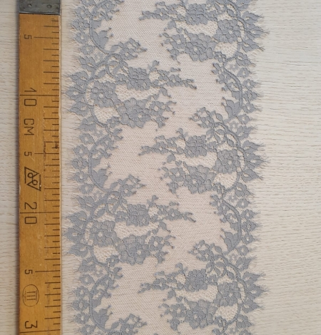 Light grey on peach tulle floral lace trimming. Photo 9