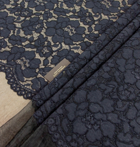 Dark blue floral guipure lace on black organza fabric. Photo 1