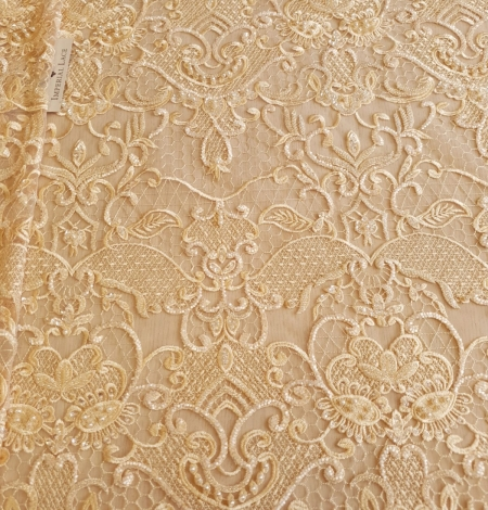 Yellow beaded lace fabric. Photo 2