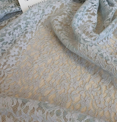 Grey with bluish green base lace fabric. Photo 4