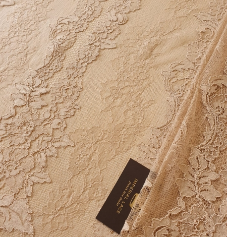 Light brown guipure with chantilly lace fabric. Photo 2