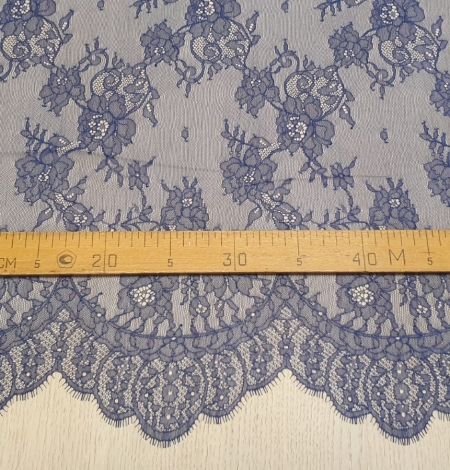 Blue chantilly lace fabric. Photo 7