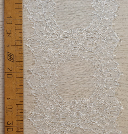 Ivory chantilly lace trimming from France. Photo 9