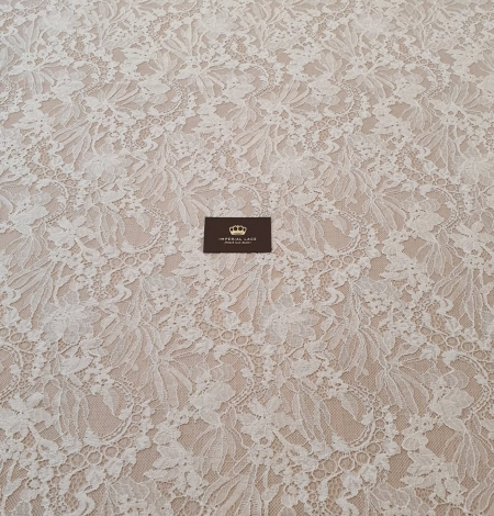 Ivory floral pattern chantilly lace fabric. Photo 7