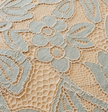 Beige with blue 70% cotton with 30% polyester guipure lace fabric . Photo 1