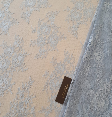 Bluish grey floral pattern chantilly lace fabric. Photo 1